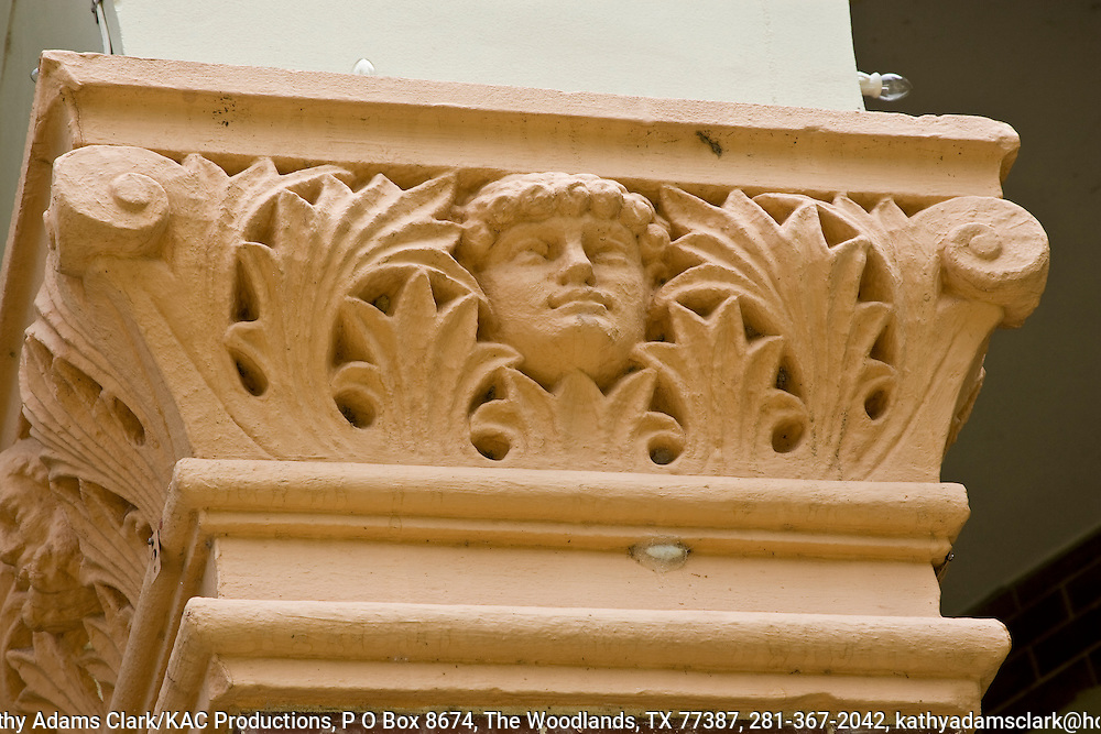 The columns of the Gonzales County Courthouse have decorative capitals with leaves, scrolls, and a face. The courhouse was built in 1895 and restored from 1992-1998.  Gonzales, Texas, Gonzales County.