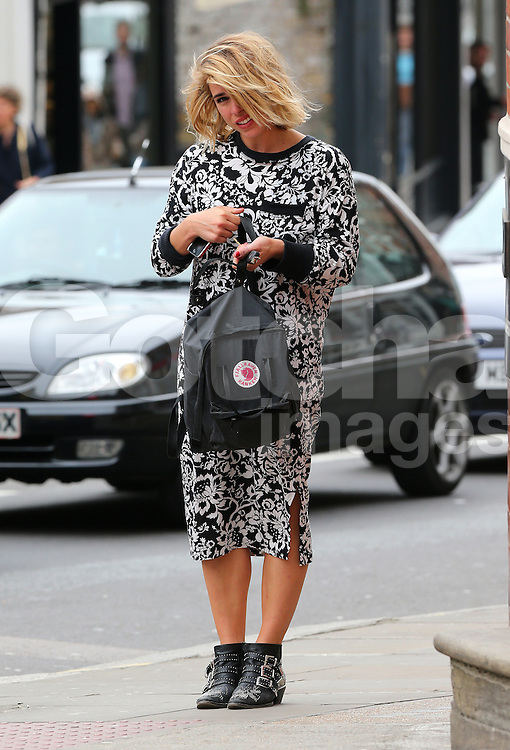 (EXCLUSIVE PICTURES) Actress Billie Piper wearing a black &amp; white floral pattern dress and a pair of Chlo&eacute; Susannah studded ankle boots visits a nail salon in north London, UK. 17/04/2014<br />