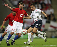Photo: Rich Eaton.<br /> <br /> England v Russia. UEFA European Championships Qualifying. 12/09/2007. Russia's Konstantin Zyryanov (L) and England's Joe Cole (R) clash