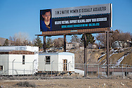 "Billboard serving as a public servuce announcemnet near the The San Juan Generating Plant just outside of Farmington, New Mexico in the Four Corners region, deemed an 'energy Sacrifice Zone,"" by the Nixon administration, is one of America's largest coal plants."