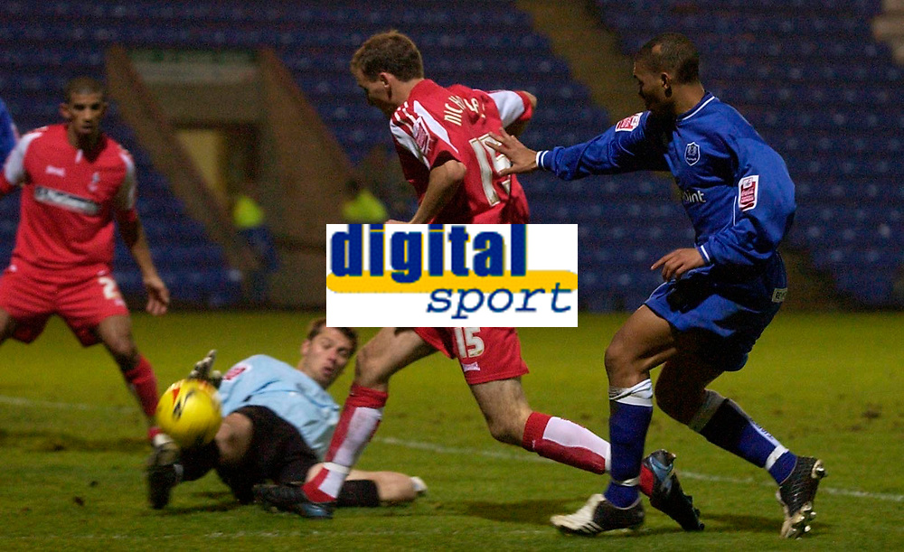 Photo: Daniel Hambury.<br />Peterborough United v Swindon Town. LDV Vans Trophy. 22/11/2005.<br />Peterborough's keeper Lee Harrison stops Swindon's Andrew Nichols from scoring with an outstretched foot.