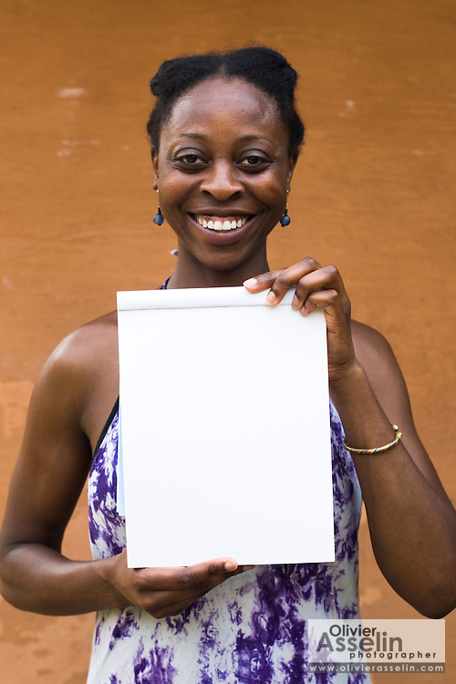 Administrative assistant Nana Ama Bentsi-Enchill holds a blank paper pad while posing for a portrait at the Kokrobitey Institute in the town of Kokrobitey, 30km west of Ghana's capital Accra on Sunday January 18, 2009.