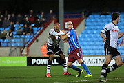David Mirfin, Calvin Andrew during the Sky Bet League 1 match between Scunthorpe United and Rochdale at Glanford Park, Scunthorpe, England on 28 December 2015. Photo by Daniel Youngs.