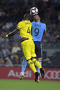 Jonathan Mendsah of Columbus SC and Heber of New York City FC goes for a header during a MLS soccer match, Wednesday, Aug. 21, 2019, in New York (Errol Anderson/Image of Sport)