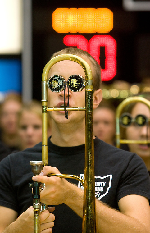 18452.A Marching 110 trombone player prepares to play during the Yell Like Hell pep rally in the Convocation Center on Friday, October 12, 2007..Photo by Kevin Riddell