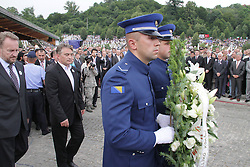 60113384  <br /> Zeljko Komsic (2nd L), chairman of the presidency of Bosnia and Herzegovina (BiH), and Bakir Izetbegovic (1st L), member of BiH Presidency, attend the ceremony to mark the 18th anniversary of the Sreberenica Massacre at the Potocari Memorial Centre near Srebrenica to mourn for victims in the 1995 Srebrenica Massacre. A total of 409 newly-identified victims were buried at the centre on the 18th anniversary of the massacre, putting the numbers of gravestones to over 6000, picture taken Thursday, July 11, 2013.<br /> Photo by imago / i-Images<br /> UK ONLY