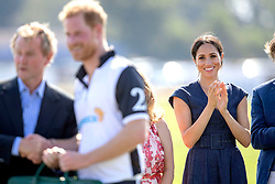The Duke and Duchess of Sussex during the Sentebale ISPS Handa Polo Cup at the Royal County of Berkshire Polo Club in Windsor.