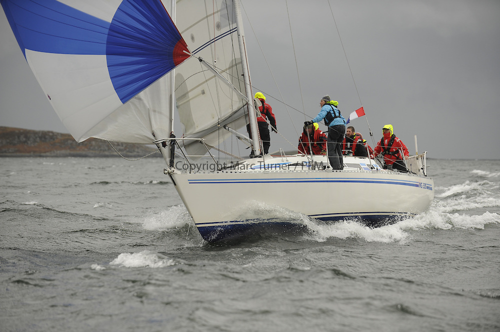The Clyde Cruising Club's Scottish Series held on Loch Fyne by Tarbert. <br /> Day 4 Racing with a wet Southerly to start clearing up for the last race.<br /> <br /> 3355C ,Pure Magic ,Des &amp; Liz Balmforth ,CCC ,MG 335