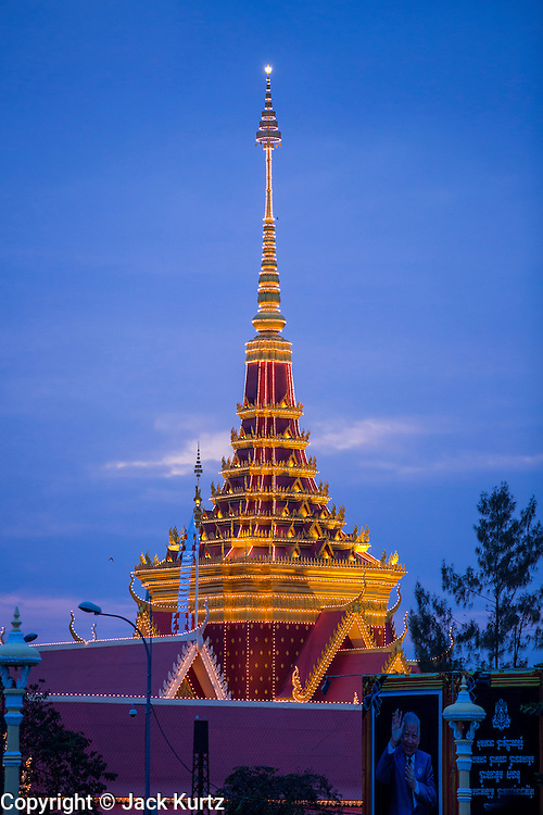 02 FEBRUARY 2013 - PHNOM PENH, CAMBODIA:  The crematorium built for former King Norodom Sihanouk is bathed in light before the King's cremation. Much of Phnom Penh has been shut down to honor former King Norodom Sihanouk, who ruled Cambodia from independence in 1953 until he was overthrown by a military coup in 1970. Only bars, restaurants and hotels that cater to foreign tourists are supposed to be open. The only music being played publicly is classical Khmer music. Sihanouk died in Beijing, China, in October 2012 and will be cremated during a state funeral royal ceremony on Monday, Feb. 4.    PHOTO BY JACK KURTZ