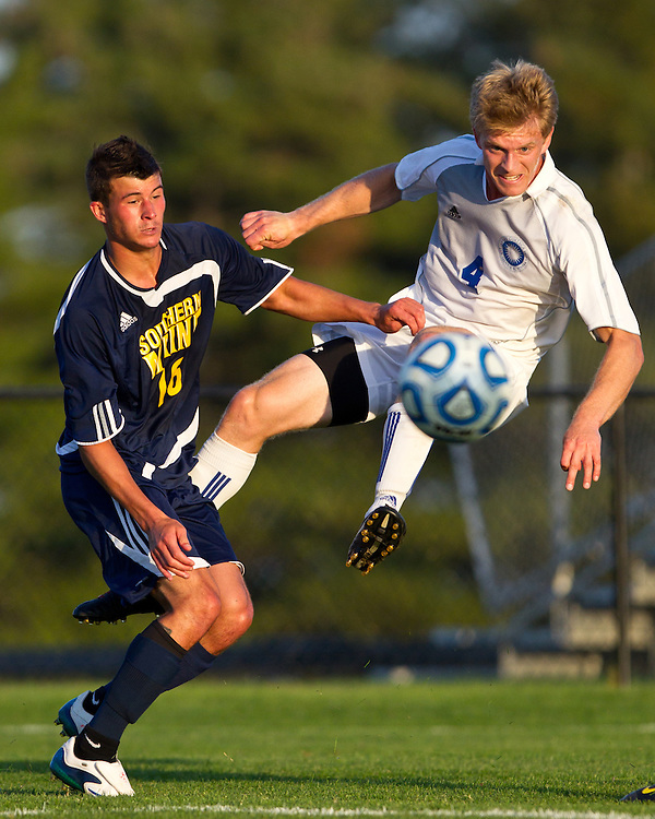 Colby College's Eric Barthold, right, takes a shot on goal as University of Southern Maine's Chase Cote defends during the second half of an NCAA Division III soccer game in Waterville, ME, Wednesday, September 28, 2011.  The Colby Mules won 4-0.