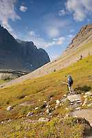 Backpacker approaching Wolvereine Pass, Kootenay National Park British Columbia Canada,