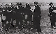 "Michael Collins chatting to some of the Kilkenny team prior to the Leinster final in September 1921. It was one of his first public appearances since the Truce had been called in July. ""Your are not only upholding the great game"", the told them, "" but you are also upholding one of the most ancient and cherished traditions of Ireland."""