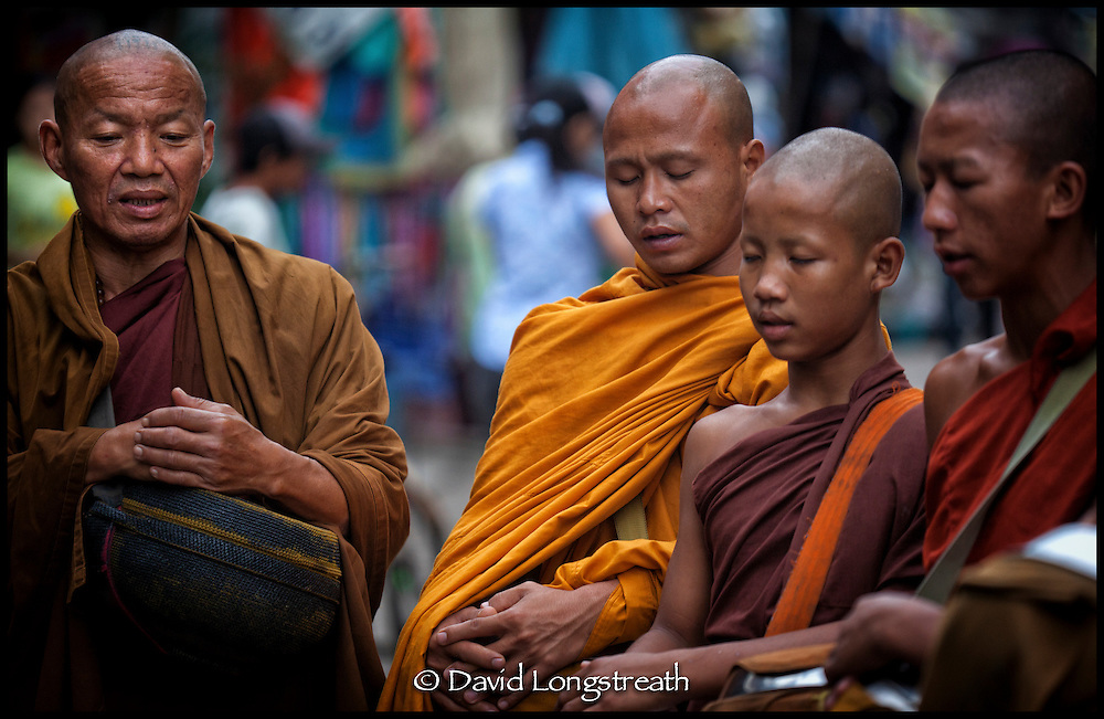 Buddhist Monks gather on their rounds in Mae Sot, Thailand.  Buddhism is the predominate religion in Thailand, Cambodia, Laos and Burma.