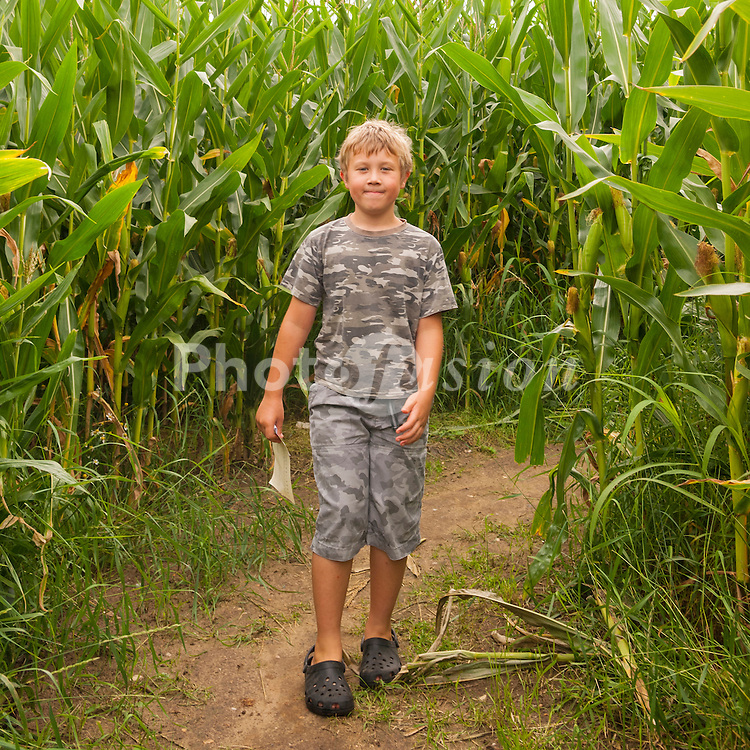 An 8 year old boy in a maze outdoors in the uk
