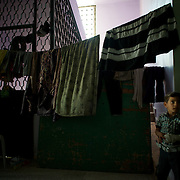 August 11, 2012 - Azaz, Aleppo, Syria: A syrian war refugee stands beside drying clothing in a improvised center in Azaz, where 32 families who fled the combat areas are temporarily living. (Paulo Nunes dos Santos)