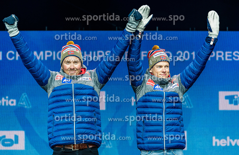 24.02.2019, Medal Plaza, Seefeld, AUT, FIS Weltmeisterschaften Ski Nordisch, Seefeld 2019, Langlauf, Herren, Teambewerb, Siegerehrung, im Bild Goldmedaillengewinner Johannes Hoesflot Klaebo (NOR), Emil Iversen (NOR) // World champion and Gold medalist Johannes Hoesflot Klaebo Emil Iversen of Norway during the winner ceremony for the men's cross country team competition of FIS Nordic Ski World Championships 2019 at the Medal Plaza in Seefeld, Austria on 2019/02/24. EXPA Pictures © 2019, PhotoCredit: EXPA/ Stefan Adelsberger