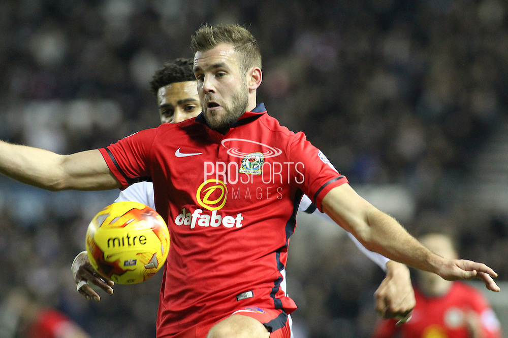 Blackburn Rovers defender Tommy Spurr controls the ball during in an attacking move during the Sky Bet Championship match between Derby County and Blackburn Rovers at the iPro Stadium, Derby, England on 24 February 2016. Photo by Aaron  Lupton.