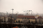Iconic shipyard cranes of Gdansk visible on skyline mixing with construction cranes.<br /> <br /> Gdansk and Remontowa Shipyards