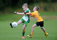 20 Aug 2016: Evan Treanor, right, Monaghan, in action against Ronan Duggan, Galway.  Gaelic U10 Boys, Galway v Monaghan.  2016 Community Games National Festival.  Athlone Institute of Technology, Athlone, Co. Westmeath. Picture: Caroline Quinn
