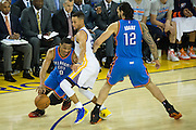 Golden State Warriors guard Stephen Curry (30) guards Oklahoma City Thunder guard Russell Westbrook (0) at Oracle Arena in Oakland, Calif., on November 3, 2016. (Stan Olszewski/Special to S.F. Examiner)