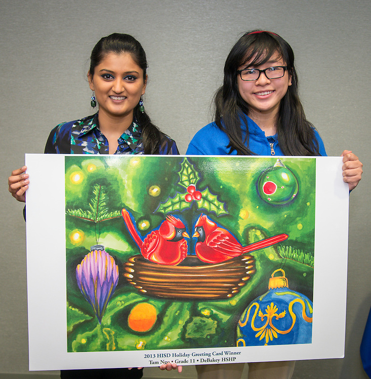 DeBakey High School art teacher Neda Khan poses with Tam Ngo and her winning design during the Houston ISD official holiday card reception, November 8, 2013.