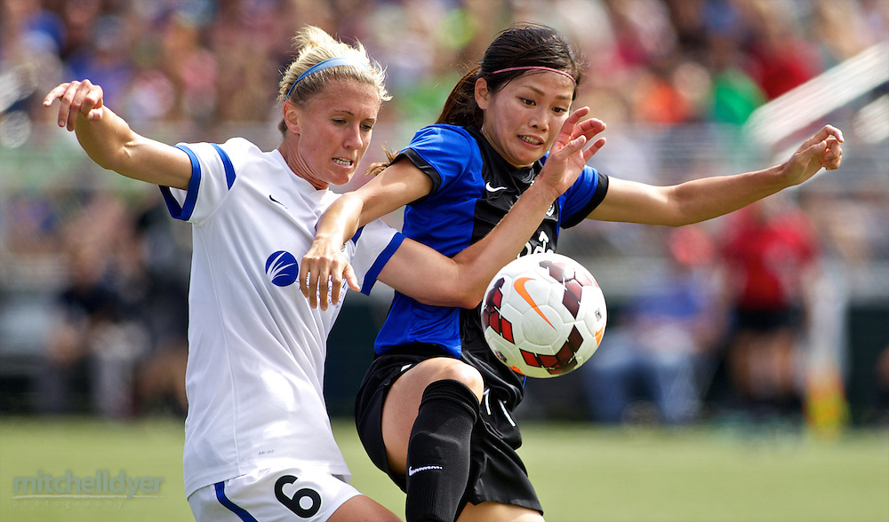 TUKWILA, WA - AUGUST 31:  Nahomi Kawasumi #9 of Seattle Reign FC fights for the ball against Jen Buczowski #6 of FC Kansas City in the first half of the National Women's Soccer League Championship on August 31, 2014 at Starfire Stadium in Tukwila, Washington.  (Photo by Craig Mitchelldyer/Getty Images) *** Local Caption *** Nahomi Kawasumi; Jen Buczowski