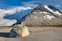 Icemaker Mountain (left) 2745 m (9006 ft) and Mount Guthrum 2695 m (8842 ft) seen from pumice covered slopes above Athelney Pass, Coast Mountains British Columbia Canada
