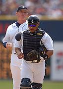 Apr 11, 2006; Detroit, MI, USA:  Detroit Tiger catcher Ivan Rodriguez returns to home plate after a conversation with Tiger starter Jeremy Bonderman, Comerica Park vs. Chicago White Sox.