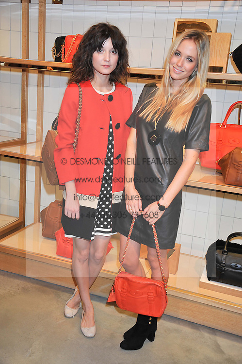 Left to right, IRINA LAZAREANU and FLORENCE BRUDENELL-BRUCE at a party to celebrate the launch of the Vogue Fashion's Night Out held at Mulberry, Bond Street, London on 6th September 2012.