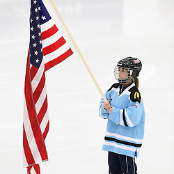 COBOURG, - Dec 14, 2015 -  Game #3 - United States vs Czech Republic at the 2015 World Junior A Challenge at the Cobourg Community Centre, ON. Cobourg Girls Minor Hockey Player holds the United States Flag during a special pre-game ceremony. (Photo: Tim Bates / OJHL Images)