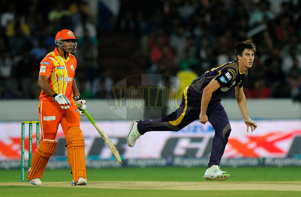 Pat Cummins of Kolkata Knight Riders bowls during match 7 of the Oppo Champions League Twenty20 between the Kolkata Knight Riders and the Lahore Lions held at the Rajiv Gandhi Cricket Stadium, Hyderabad, India on the 21st September 2014<br /> <br /> Photo by:  Pal Pillai / Sportzpics/ CLT20<br /> <br /> <br /> Image use is subject to the terms and conditions as laid out by the BCCI/ CLT20.  The terms and conditions can be downloaded here:<br /> <br /> http://sportzpics.photoshelter.com/gallery/CLT20-Image-Terms-and-Conditions-2014/G0000IfNJn535VPU/C0000QhhKadWcjYs