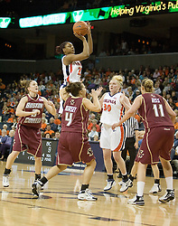 Monica Wright (22) elevates over Boston College on a jump shot.  The Cavaliers defeated the Eagles 65-63 in overtime at the John Paul Jones Arena in Charlottesville, VA on January 14, 2007.