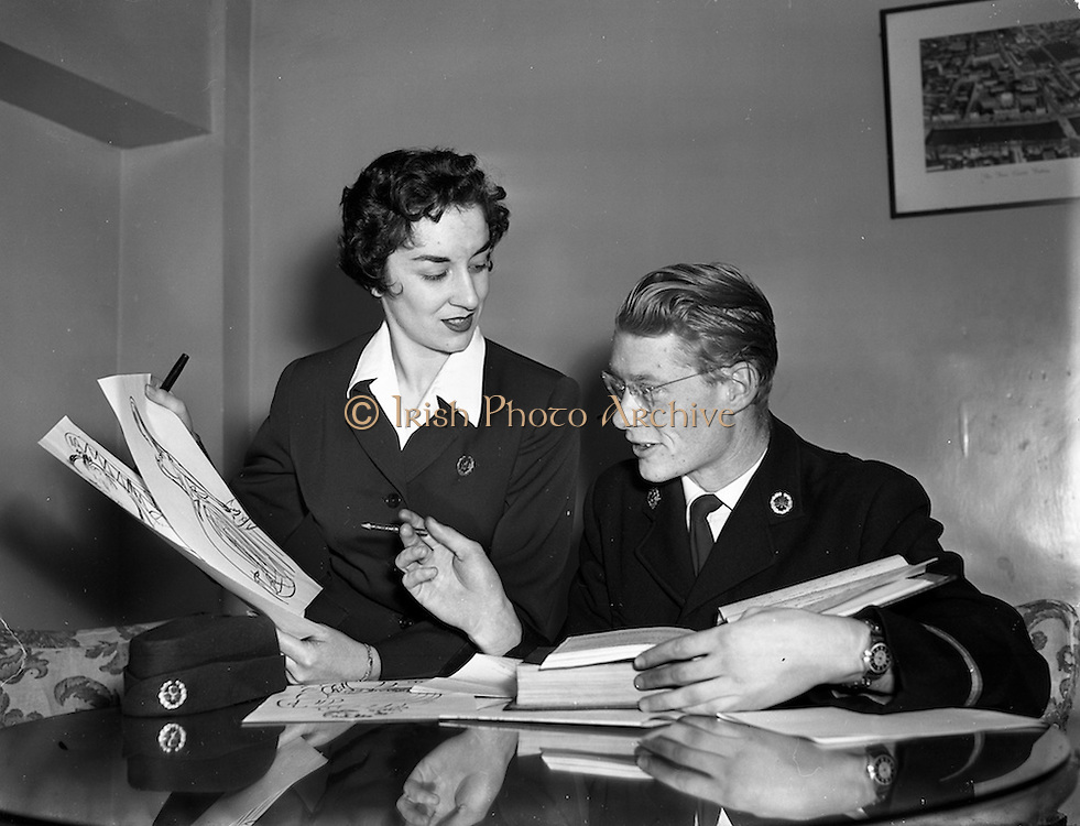 12/11/1954<br /> 11/12/1954<br /> 12 November 1954 <br /> Aer Lingus workers Argina Galastegi and Bart Cronin prepare to stage &quot;Fly way Wild Eagle&quot;, pictured here discussing details at the Aer Lingus office on Cathal Brugha Street, Dublin.