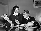 "1954 - Aer Lingus workers Argina Galastegi and Bart Cronin prepare to stage ""Fly way Wild Eagle"""