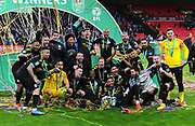 The players celebrate winning the Carabao Trophy and group together for a photo with the trophy during the Carabao Cup Final match between Aston Villa and Manchester City at Wembley Stadium, London, England on 1 March 2020.