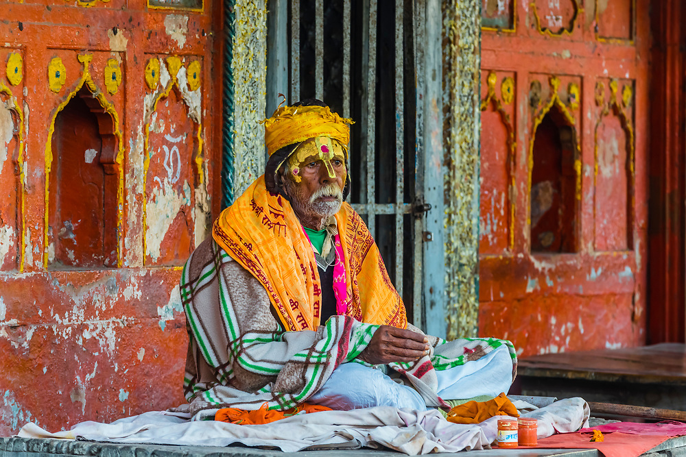 A sadhu (holy man) sits near the Yamuna River, Mathura, Uttar Pradesh, India.