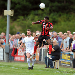 TELFORD COPYRIGHT MIKE SHERIDAN Steph Morley is outjumped by Daniel Nti during the National League North fixture between Kettering Town and AFC Telford United at Latimer Park on Saturday, August 3, 2019<br /> <br /> Picture credit: Mike Sheridan<br /> <br /> MS201920-005