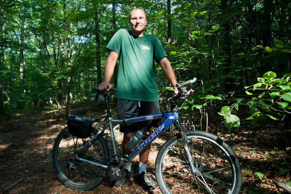 Lathan Goumas | The Bay City Times..Bryan Skiendziel at Roethke Park in Thomas Township, MI., on Wednesday August 24, 2011. Skiendziel is works at the park as a maintenance man and ride his bike to work every day. The park recently opened a mountain bike trail.
