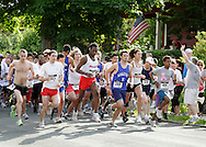 Middletown, New York - Runners take off at the starte of the 15th annual Ruthie Dino Marshall 5K Run and Fun Walk hosted by the Middletown YMCA on Sunday, June 5, 2011. Race director George Marshall is sounding the starting air horn at far right. ©Tom Bushey / The Image Works