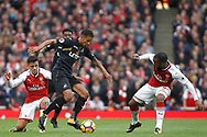 Kyle Naughton of Swansea City &copy; takes on Alexis Sanchez (L) &amp; Alexandre Lacazette of Arsenal (R). Premier league match, Arsenal v Swansea city at the Emirates Stadium in London on Saturday 28th October 2017.<br /> pic by Steffan Bowen, Andrew Orchard sports photography.