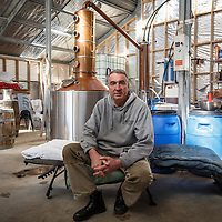 McHenry Distillery owner Bill McHenry sits on his cot at McHenry Distillery in Port Arthur, Tasmania, August 25, 2015. The small size of the still necessitates running it 48 hours straight, forcing McHenry to sleep in the distillery to monitor the process. Gary He/DRAMBOX MEDIA LIBRARY
