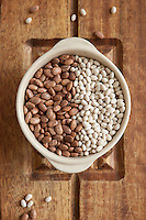 A bowl of dried kidney beans and dried navy beans in a bowl.