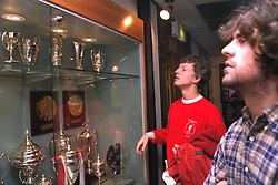 "LIVERPOOL, ENGLAND - 1996: John Power (L) and Peter ""Cammy"" Cammell of band Cast in the trophy room at Anfield, home of Liverpool FC. (Pic by David Rawcliffe/Propaganda)"