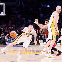09 February 2014: Los Angeles Lakers point guard Steve Blake (5) drives past Chicago Bulls point guard D.J. Augustin (14) on a screen set by Los Angeles Lakers center Chris Kaman (9) during the Chicago Bulls 92-86 victory over the Los Angeles Lakers at the Staples Center, Los Angeles, California, USA.