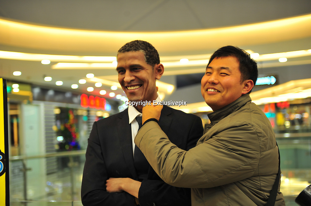 SHENYANG, CHINA - DECEMBER 04:  China Out- Finland Out<br /> <br /> Barack Obama Wax Figure Appears In Shenyang<br /> <br /> A man poses with a wax figure of U.S. President Barack Obama at a shopping mall on December 4, 2013 in Shenyang, Liaoning Province of China. <br /> ©Exclusivepix