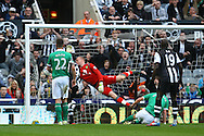 Picture by Paul Chesterton/Focus Images Ltd.  07904 640267.18/03/12.Papiss Cisse scores his sides 1st goal and celebrates during the Barclays Premier League match at St James' Park Stadium, Newcastle.