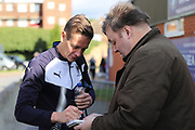 AFC Wimbledon defender Paul Robinson (6) signing autographs during the EFL Sky Bet League 1 match between AFC Wimbledon and Peterborough United at the Cherry Red Records Stadium, Kingston, England on 12 November 2017. Photo by Matthew Redman.