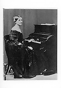 Clara Schumann, 1819-96, German musician and composer of the Romantic Era, wife of Robert Schumann, at the piano, photograph, c. 1860. Copyright © Collection Particuliere Tropmi / Manuel Cohen