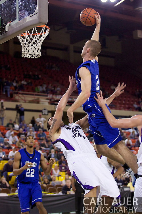 November 27th, 2010:  Anchorage, Alaska - Drake Bulldog forward Aaron Hawley (2) is fouled in his monster dunk attempt in the Bulldog's 81-82 loss to Weber State in the third place game of the Great Alaska Shootout.