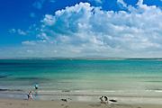 Family fun at the sandy beach on the west coast near Doonbeg, County Clare, West Coast of Ireland